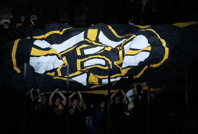 BOSTON - MAY 14:  Fans pass a giant flag before the Boston Bruins take on the Philadelphia Flyers in Game Seven of the Eastern Conference Semifinals during the 2010 NHL Stanley Cup Playoffs at TD Garden on May 14, 2010 in Boston, Massachusetts.  (Photo by