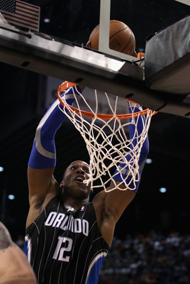 PHOENIX, AZ - MARCH 13:  Dwight Howard #12 of the Orlando Magic slam dunks the ball during the NBA game against the Phoenix Suns at US Airways Center on March 13, 2011 in Phoenix, Arizona. The Magic defeated the Suns 111-88. NOTE TO USER: User expressly a
