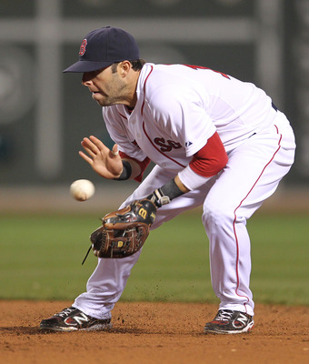 BOSTON, MA - APRIL 11:  Dustin Pedroia #15 of the Boston Red Sox makes an assist against the Tampa Bay Rays at Fenway Park April 11, 2011 in Boston, Massachusetts. (Photo by Jim Rogash/Getty Images)