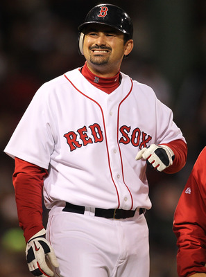 BOSTON, MA - APRIL 10:  Adrian Gonzalez #28 of the Boston Red Sox reacts after being hit by a pitch against the New York Yankees at Fenway Park April 10, 2011 in Boston, Massachusetts. (Photo by Jim Rogash/Getty Images)