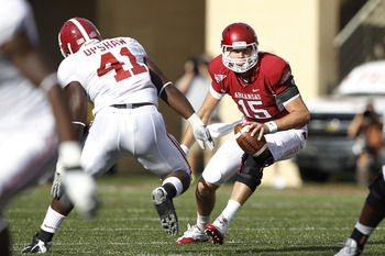 FAYETTEVILLE - SEPTEMBER 25: Ryan Mallett #15 of the Arkansas Razorbacks tries to avoid pressure from Courtney Upshaw #41 of the Alabama Crimson Tide at Donald W. Reynolds Razorback Stadium on September 25, 2010 in Fayetteville, Arkansas. Alabama won 24-2