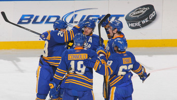 BUFFALO, NY - APRIL 05: Thomas Vanek #26 (Above-Center) of the Buffalo Sabres celebrates with teammates after scoring Buffalo's first goal against the Tampa Bay Lightning at HSBC Arena on April 5, 2011 in Buffalo, New York.  (Photo by Rick Stewart/Getty I