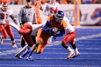 BOISE, ID - NOVEMBER 19:  Austin Pettis #2 of the Boise State Broncos runs after a catch against the Fresno State Bulldogs at Bronco Stadium on November 19, 2010 in Boise, Idaho.  (Photo by Otto Kitsinger III/Getty Images)
