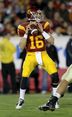 LOS ANGELES, CA - NOVEMBER 27:  Quarterback Mitch Mustain #16 of the USC Trojans drops back to throw a pass against the Notre Dame Fighting Irish at the Los Angeles Memorial Coliseum on November 27, 2010 in Los Angeles, California.  (Photo by Stephen Dunn