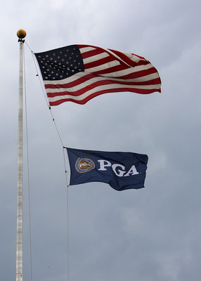 BLOOMFIELD HILLS, MI - AUGUST 09:  The American Flag and PGA of America Flag fly in the wind during a weather dellay during round three of the 90th PGA Championship at Oakland Hills Country Club on August 9, 2008 in Bloomfield Township, Michigan.  (Photo