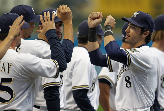 MILWAUKEE, WI - APRIL 04: Ryan Braun #8 of the Milwaukee Brewers greets teammates during player inrtoductions before the home opener against the Atlanta Braves at Miller Park on April 4, 2011 in Milwaukee, Wisconsin. The Braves defeated the Brewers 2-1. (