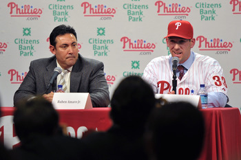 PHILADELPHIA - DECEMBER 15: Pitcher Cliff Lee #33 of the Philadelphia Phillies talks with the media while general manager Ruben Amaro Jr. (L) watches during a press conference at Citizens Bank Park on December 15, 2010 in Philadelphia, Pennsylvania. (Phot