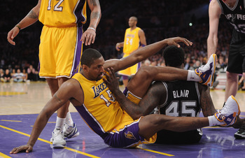 LOS ANGELES, CA - APRIL 12:  Ron Artest #15 of the Los Angeles Lakers and DeJuan Blair #45 of the San Antonio Spurs get tangled at Staples Center on April 12, 2011 in Los Angeles, California.  NOTE TO USER: User expressly acknowledges and agrees that, by