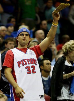 ORLANDO, FL - APRIL 28:  A Pistons' fan waves a broom as the Orlando Magic fail to win a game against the Detroit Pistons in Game Four of the Eastern Conference Quarterfinals during the 2007 NBA Playoffs at Amway Arena on April 28, 2007 in Orlando, Florid