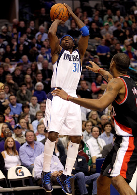 DALLAS, TX - JANUARY 04:  Guard Jason Terry #31 of the Dallas Mavericks takes a shot against Marcus Camby #23 of the Portland Trail Blazers at American Airlines Center on January 4, 2011 in Dallas, Texas.  NOTE TO USER: User expressly acknowledges and agr