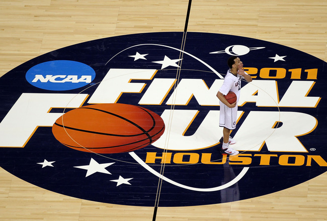 HOUSTON, TX - APRIL 04:  Shabazz Napier #13 of the Connecticut Huskies with the ball against the Butler Bulldogs in the National Championship Game of the 2011 NCAA Division I Men's Basketball Tournament at Reliant Stadium on April 4, 2011 in Houston, Texa