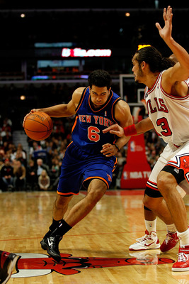 CHICAGO - NOVEMBER 04: Landry Fields #6 of the New York Knicks drives against Joakim Noah #13 of the Chicago Bulls at the United Center on November 4, 2010 in Chicago, Illinois. The Knicks defeated the Bulls 120-112. NOTE TO USER: User expressly acknowled