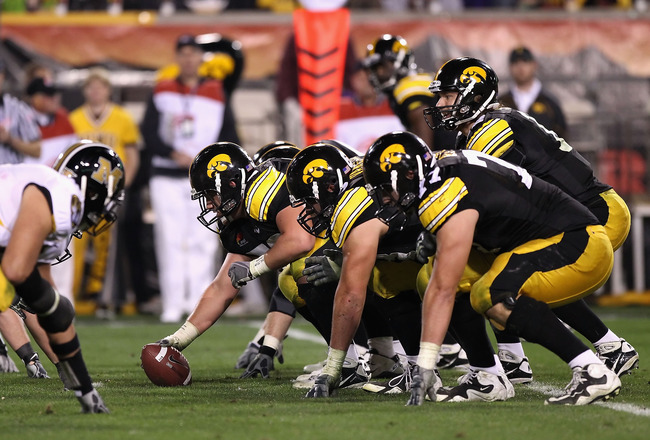 TEMPE, AZ - DECEMBER 28:  Quarterback Ricky Stanzi #12 of the Iowa Hawkeyes prepares to snap the ball during the Insight Bowl against the Missouri Tigers at Sun Devil Stadium on December 28, 2010 in Tempe, Arizona.  The Hawkeyes defeated the Tigers 27-24.