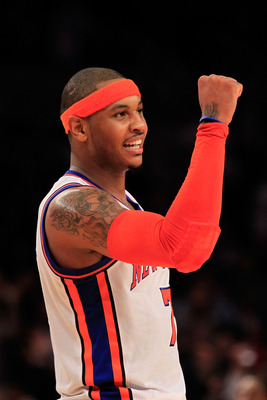 NEW YORK, NY - MARCH 30:  Carmelo Anthony #7 of the New York Knicks celebrates during the game against the New Jersey Nets at Madison Square Garden on March 30, 2011 in New York City. NOTE TO USER: User expressly acknowledges and agrees that, by downloadi