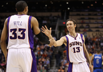 PHOENIX, AZ - MARCH 27:  Steve Nash #13 of the Phoenix Suns high fives teammate Grant Hill #33 during the NBA game against the Dallas Mavericks at US Airways Center on March 27, 2011 in Phoenix, Arizona. The Mavericks defeated the Suns 91-83.  NOTE TO USE
