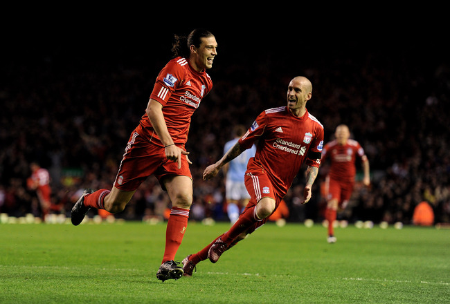LIVERPOOL, ENGLAND - APRIL 11:  Andy Carroll of Liverpool celebrates scoring the opening goal with team mate Raul Meireles (R) during the Barclays Premier League match between Liverpool and Manchester City at Anfield on April 11, 2011 in Liverpool, Englan
