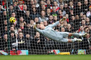 LONDON, ENGLAND - FEBRUARY 27:  Pepe Reina goalkeeper of Liverpool fails to stop the shot of Scott Parker of West Ham during the Barclays Premier League match between West Ham United and Liverpool at the Boleyn Ground on February 27, 2011 in London, Engla