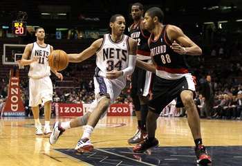 EAST RUTHERFORD, NJ - FEBRUARY 23:  Devin Harris #34 of the New Jersey Nets drives against Nicolas Batum #88 of the Portland Trail Blazers at the Izod Center on February 23, 2010 in East Rutherford, New Jersey.The Blazers defeated the Nets 102-93.NOTE TO