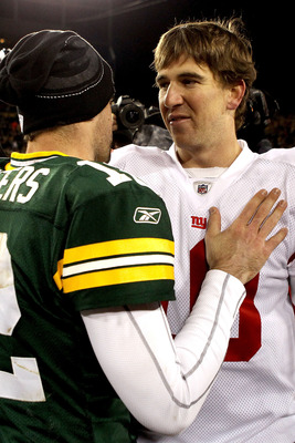 GREEN BAY, WI - DECEMBER 26:  Aaron Rodgers #12 of the Green Bay Packers is congratulated by Eli Manning #10 of the New York Giants after their game at Lambeau Field on December 26, 2010 in Green Bay, Wisconsin.  (Photo by Matthew Stockman/Getty Images)