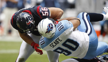 HOUSTON - NOVEMBER 28:  Linebacker Brian Cushing #56 of the Houston Texans lays a hard hit on tight end Bo Scaife #80 of the Tennessee Titans at Reliant Stadium on November 28, 2010 in Houston, Texas.  (Photo by Bob Levey/Getty Images)