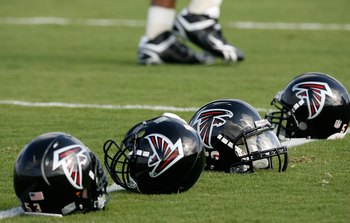 FLOWERY BRANCH, GA - AUGUST 01:  Atlanta Falcons' helmets sit on field during opening day of training camp on August 1, 2009 at the Falcons Training Complex in Flowery Branch, Georgia.  (Photo by Kevin C. Cox/Getty Images)