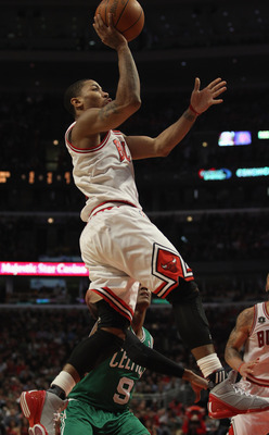 CHICAGO, IL - APRIL 07: Derrick Rose #1 of the Chicago Bulls puts up a shot against the Boston Celtics at United Center on April 7, 2011 in Chicago, Illinois. The Bulls defeated the Celtics 97-81. NOTE TO USER: User expressly acknowledges and agress that,