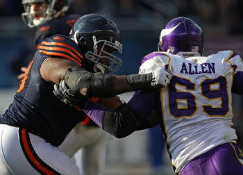CHICAGO - NOVEMBER 14: Frank Omiyale #68 of the Chicago Bears grabs Jared Allen #69 of the Minnesota Vikings at Soldier Field on November 14, 2010 in Chicago, Illinois. The Bears defeated the Vikings 27-13. (Photo by Jonathan Daniel/Getty Images)