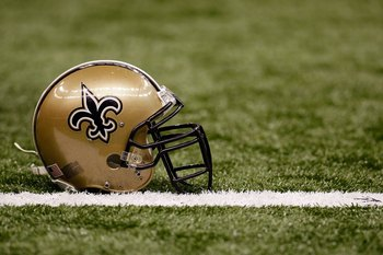NEW ORLEANS - DECEMBER 19:  A helmet of the New Orleans Saints sits on the ground before the game against the Dallas Cowboys at the Louisiana Superdome on December 19, 2009 in New Orleans, Louisiana.  (Photo by Chris Graythen/Getty Images)