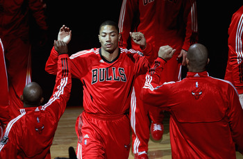 CHICAGO, IL - APRIL 13: Derrick Rose #1 of the Chicago Bulls is greeted by teammates during player introductions before a game against the New Jersey Nets at United Center on April 13, 2011 in Chicago, Illinois. The Bulls defeated the Nets 97-92. NOTE TO