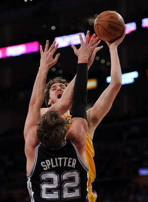 LOS ANGELES, CA - APRIL 12:  Pau Gasol #16 of the Los Angeles Lakers shoots a jumper over Tiago Splitter #22 of the San Antonio Spurs at Staples Center on April 12, 2011 in Los Angeles, California.  NOTE TO USER: User expressly acknowledges and agrees tha