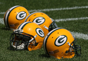 GREEN BAY, WI - AUGUST 03: Helmets sit on the field during the Green Bay Packers practice at summer training camp on August 3, 2009 at the Ray Nitschke Field in Green Bay, Wisconsin. (Photo by Jonathan Daniel/Getty Images)