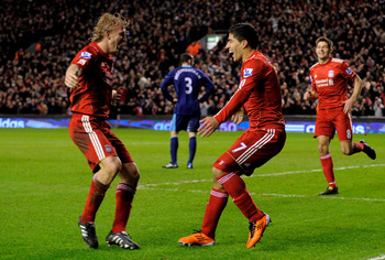 LIVERPOOL, ENGLAND - FEBRUARY 02: Luis Suarez of Liverpool celebrates with team-mate Dirk Kuyt (L) after scoring the 2-0 goal during the Barclays Premier League match between Liverpool and Stoke City at Anfield on February 2, 2011 in Liverpool, England. (