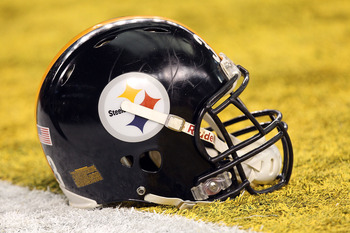 ARLINGTON, TX - FEBRUARY 06:  A Pittsburgh Steelers helmet sit in the endzone before the Steelers take on the Green Bay Packers during Super Bowl XLV at Cowboys Stadium on February 6, 2011 in Arlington, Texas.  (Photo by Ronald Martinez/Getty Images)