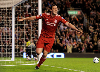 LIVERPOOL, ENGLAND - APRIL 11:  Andy Carroll of Liverpool celebrates scoring his team's third goal during the Barclays Premier League match between Liverpool and Manchester City at Anfield on April 11, 2011 in Liverpool, England.  (Photo by Michael Regan/