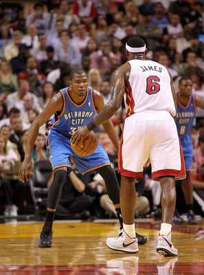 MIAMI, FL - MARCH 16: LeBron James #6 of the Miami Heat is guarded by Kevin Durant #35 of the Oklahoma City Thunder during a game at American Airlines Arena on March 16, 2011 in Miami, Florida. NOTE TO USER: User expressly acknowledges and agrees that, by