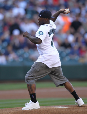SEATTLE - JULY 23: Former Washington Husky and current member of the Boston Celtics Nate Robinson, throws out the ceremonial first pitch prior to the game between the Seattle Mariners and the Boston Red Sox at Safeco Field on July 23, 2010 in Seattle, Was
