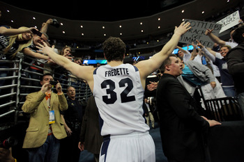 DENVER, CO - MARCH 19:  Jimmer Fredette #32 of the Brigham Young Cougars runs off of the court after defeating the Gonzaga Bulldogs during the third round of the 2011 NCAA men's basketball tournament at Pepsi Center on March 19, 2011 in Denver, Colorado.