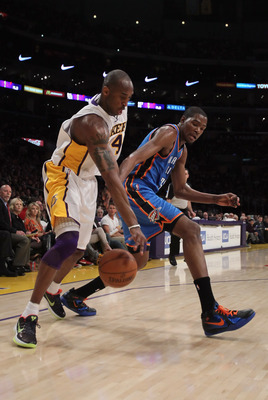 LOS ANGELES, CA - APRIL 10:  Kobe Bryant #24 of the Los Angeles Lakers steals the ball from Kevin Durant #35 of the Oklahoma City Thunder in the first half at Staples Center on April 10, 2011 in Los Angeles, California. The Thunder defeated the Lakers 120