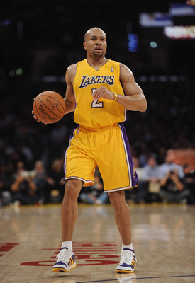 LOS ANGELES, CA - APRIL 12:  Derek Fisher #2 of the Los Angeles Lakers dribbles against the San Antonio Spurs at Staples Center on April 12, 2011 in Los Angeles, California.  NOTE TO USER: User expressly acknowledges and agrees that, by downloading and or
