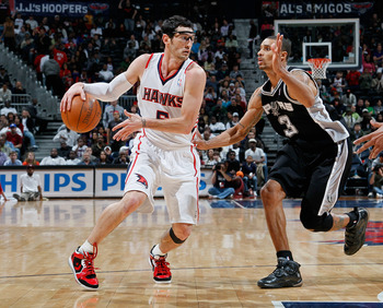 ATLANTA, GA - APRIL 05:  Kirk Hinrich #6 of the Atlanta Hawks against George Hill #3 of the San Antonio Spurs at Philips Arena on April 5, 2011 in Atlanta, Georgia.  NOTE TO USER: User expressly acknowledges and agrees that, by downloading and/or using th