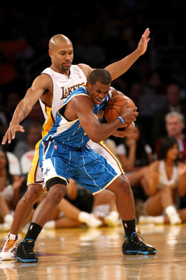 LOS ANGELES, CA - NOVEMBER 08:  Chris Paul #3 of the New Orleans Hornets fights to control the ball as Derek Fisher #3 of the Los Angeles Lakers defends on November 8, 2009 at Staples Center in Los Angeles, California. The Lakers won 104-88.  NOTE TO USER