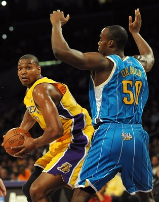 LOS ANGELES, CA - DECEMBER 01:  Andrew Bynum #17 of the Los Angeles Lakers turns to the basket in front of Emeka Okafor #50 of the New Orleans Hornets at Staples Center on December 1, 2009 in Los Angeles, California.  (Photo by Harry How/Getty Images) NOT