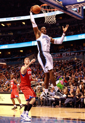 ORLANDO, FL - DECEMBER 18:  Dwight Howard #12 of the Orlando Magic attempts a shot during the game against the Philadelphia 76ers at Amway Arena on December 18, 2010 in Orlando, Florida.  NOTE TO USER: User expressly acknowledges and agrees that, by downl