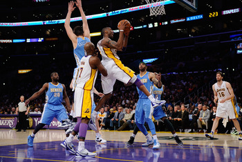 LOS ANGELES, CA - APRIL 03:  Kobe Bryant #24 of the Los Angeles Lakers drives to the basket against the Denver Nuggets during the NBA basketball game at Staples Center on April 3, 2011 in Los Angeles, California. NOTE TO USER: User expressly acknowledges