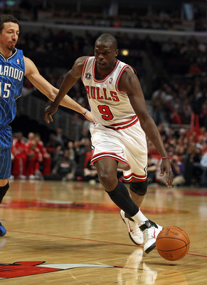 CHICAGO, IL - JANUARY 28: Loul Deng #9 of the Chicago Bulls drives past Hedo Turkoglu #15 of the Orlando Magic at the United Center on January 28, 2011 in Chicago, Illinois. The Bulls defeated the Magic 99-90. NOTE TO USER: User expressly acknowledges and