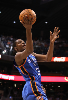 PHOENIX, AZ - MARCH 30:  Kevin Durant #35 of the Oklahoma City Thunder puts up a shot during the NBA game against the Phoenix Suns at US Airways Center on March 30, 2011 in Phoenix, Arizona. The Thunder defeated the Suns 116-98.   NOTE TO USER: User expre