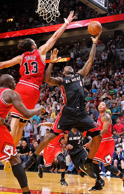 MIAMI, FL - MARCH 06:  LeBron James #6 of the Miami Heat shoots over Joakim Noah #13 of the Chicago Bulls during a game at American Airlines Arena on March 6, 2011 in Miami, Florida. NOTE TO USER: User expressly acknowledges and agrees that, by downloadin