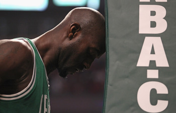 CHICAGO, IL - APRIL 07: Kevin Garnett #5 of the Boston Celtics puts his head the pad of the stanchion before a game against the Chicago Bulls at United Center on April 7, 2011 in Chicago, Illinois. The Bulls defeated the Celtics 97-81. NOTE TO USER: User