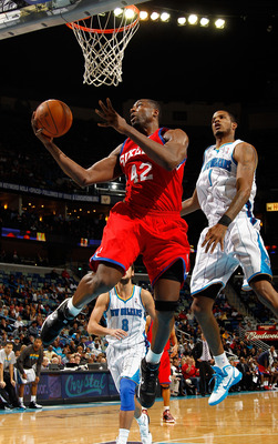 NEW ORLEANS, LA - JANUARY 03:  Elton Brand #42 of the Philadelphia 76ers goes up for a shot in front of Trevor Ariza #1 of the New Orleans Hornets in the second half at New Orleans Arena on January 3, 2011 in New Orleans, Louisiana. NOTE TO USER: User exp