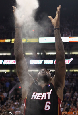 PHOENIX - DECEMBER 23:  LeBron James #6 of the Miami Heat throws chalk into the air before the NBA game against the Phoenix Suns at US Airways Center on December 23, 2010 in Phoenix, Arizona.  The Heat defeated the Suns 95-83.  NOTE TO USER: User expressl